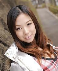 Asian cutie posing outdoors