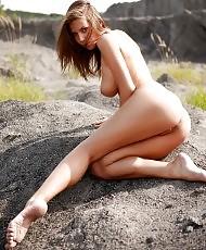 Busty brunette posing naked