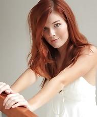 Sexy redhead posing