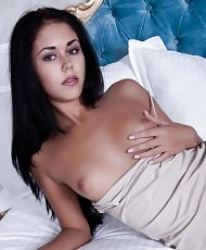 Babe masturbates in a bed