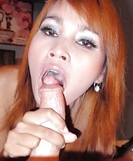 Petite redhead on a big cock
